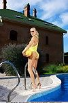 Highly-stylized way accentuate Liza s fascinating girl as this chick removes clothes off her bright yellow swimsuit to take a dip fall in love with the bright blue water of the pool.
