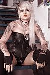 Wild tattooed elegant waste goth in leather corset