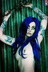 Blue haired appealing and tattooed gothic gal