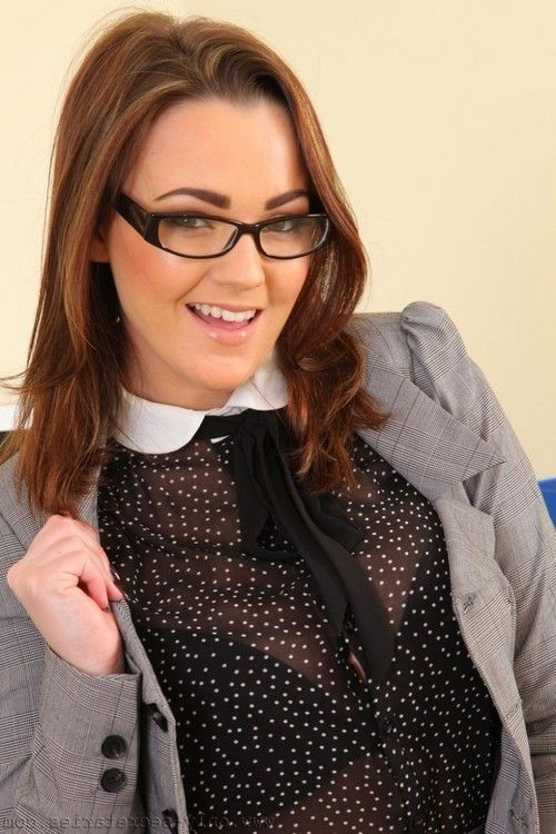 Busty curvy chick teasing in the office