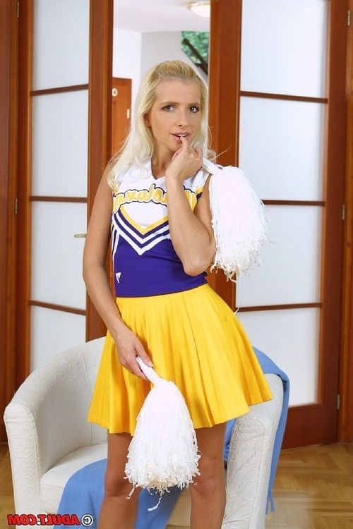 Frisky blonde cheerleader getting naked and exposing her slim curves