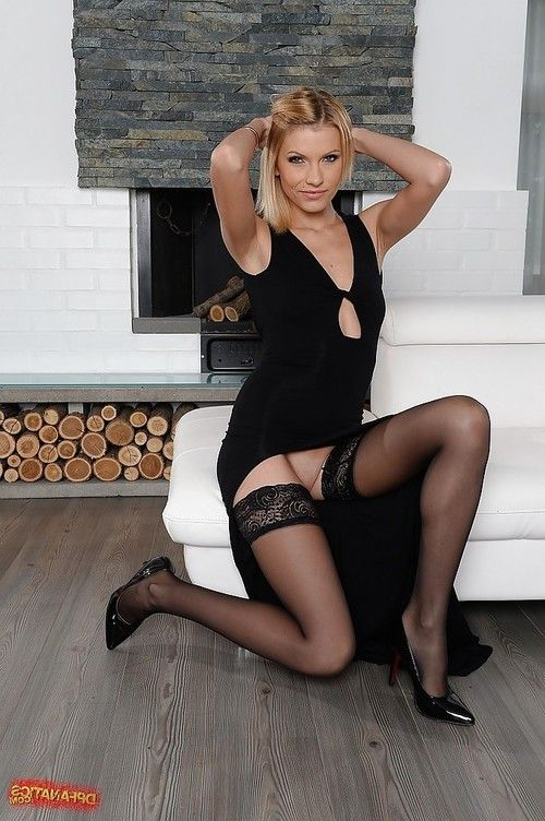 Upskirt posing scene with a skinny blonde Lana Roberts in stockings