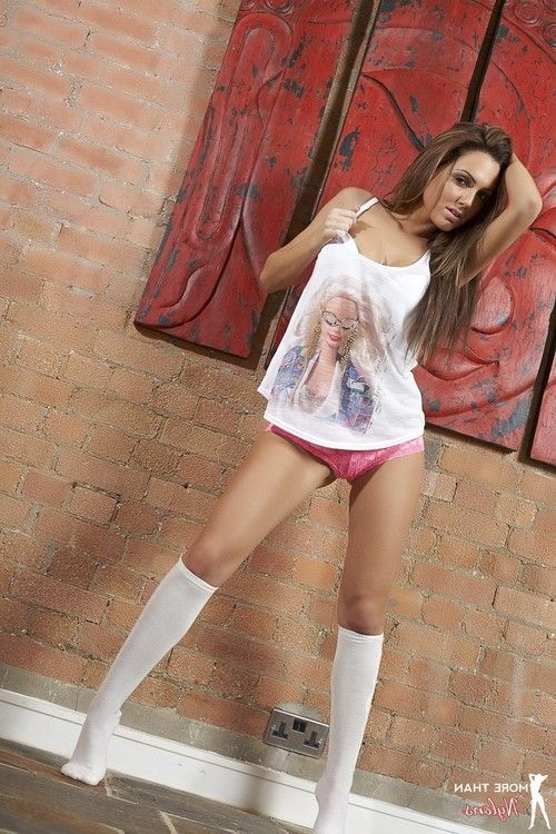 Beauty babe in her pink panties and white socks