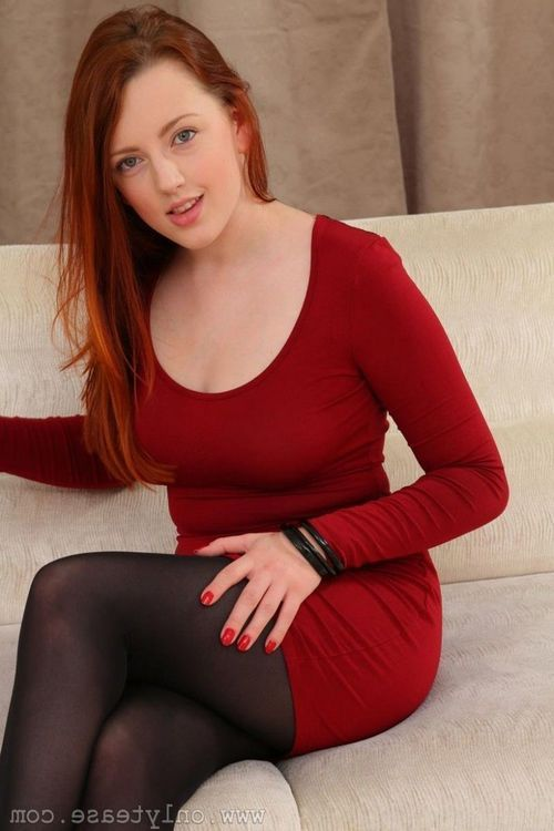 Attractive redhead in black pantyhose
