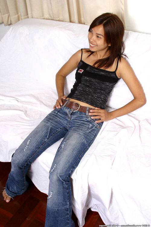Amateur Asian babe in jeans revealing big natural tits while stripping