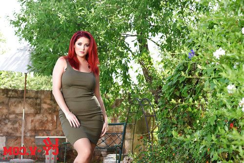 Overweight redhead Lucy V unveiling big natural boobs during slow striptease
