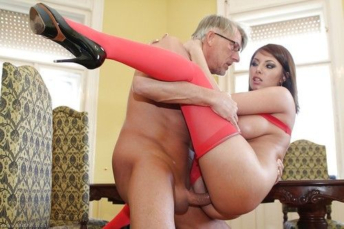 Busty hottie Donna Bell gives a titjob and gets banged hardcore