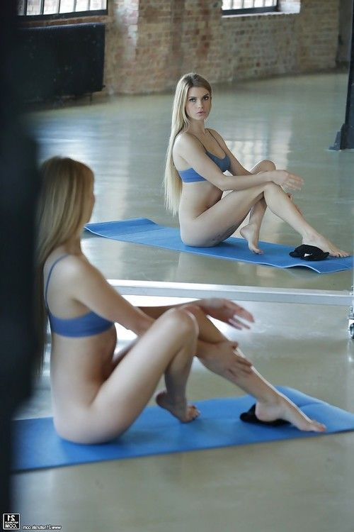 Gorgeous Euro pornstar Lana Roberts shows off bare feet during yoga session