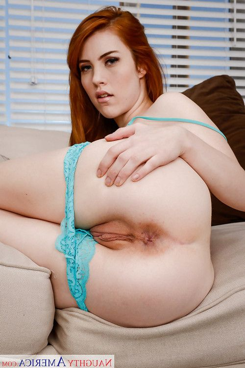 Redhead solo model Gwen Stark exposing nice pair of all natural boobs