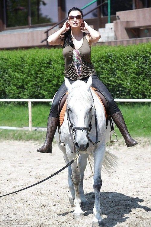 Pornstar Aletta Ocean is riding a horse outdoor in glasses