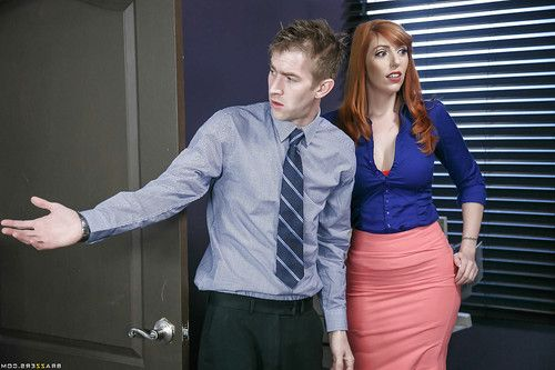 Redhead office worker Lauren Phillips bares big tits during oral sex action