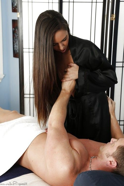 Brunette masseuse Layla Luxxx undressing for naked massage and blowjob