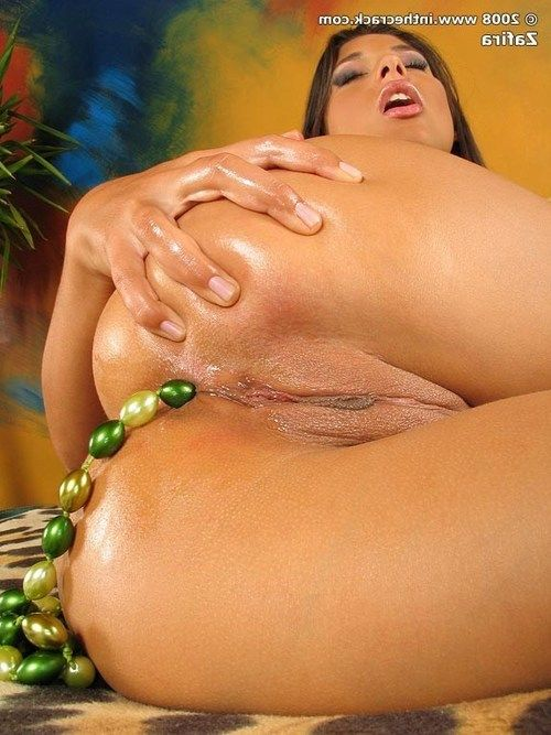 Sensual brunette playgirl Zafira has some fun with anal beads