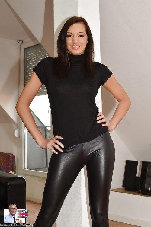 Dark haired model flashing natural tits before pulling down black latex pants