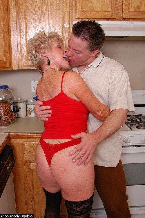 Stocking attired granny Jewel taking cumshot on boobs in kitchen