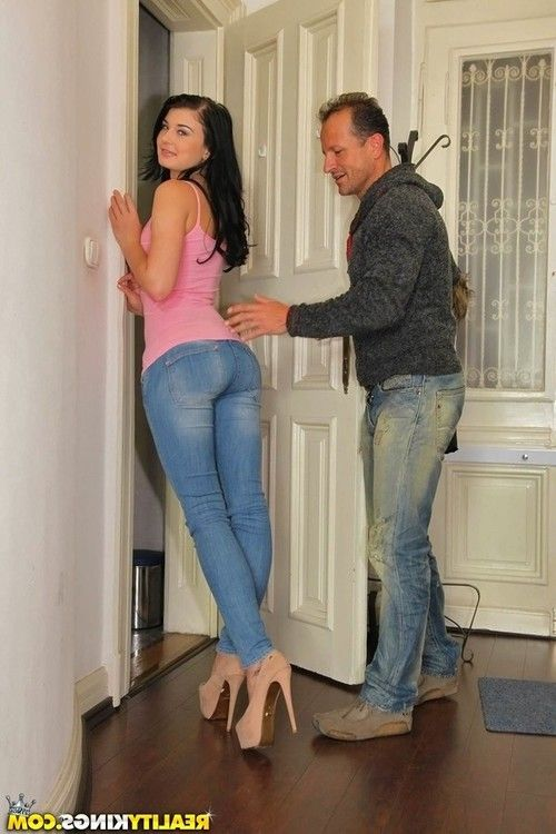Brunette amateur sheds jeans & gives handjob to get cum covered wearing heels