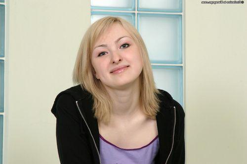 Playful blonde girl in white socks undressing and exposing her hairy slit