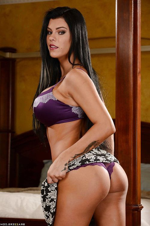 Busty brunette wife Peta Jensen exposes tattoos and ass for solo girl shoot
