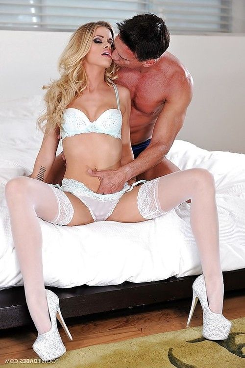 Slender blonde Jessa Rhodes is giving a deep blowjob on the camera