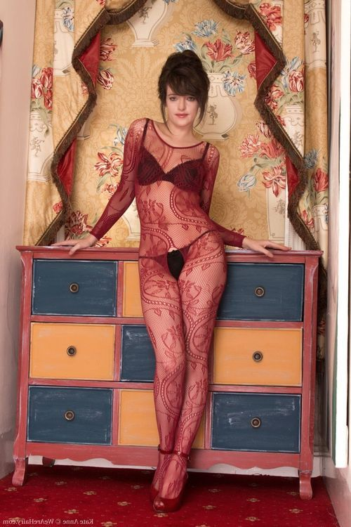 In her body stocking and underware Kate Anne removes clothes