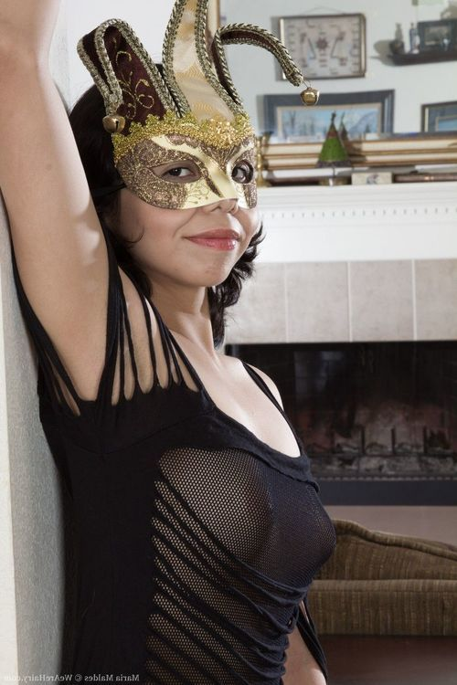 Maria Maldes is sexy in her ebony lingerie and gold mask. This babe slowly undresses and shows off her sexy 19 year-old all-natural figure and 32B breasts. Her wavy pussy though is fascinating on the floor.