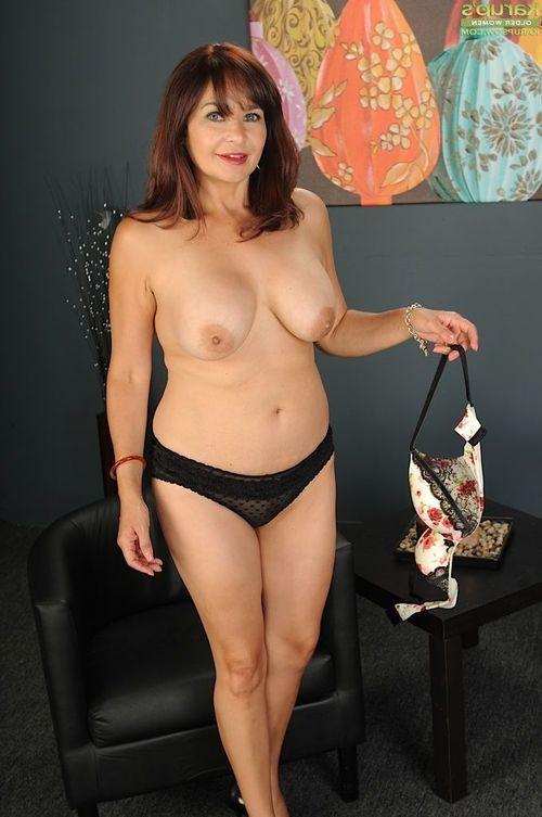Older redhead Natasha Oliwski spreads her perfect pussy.