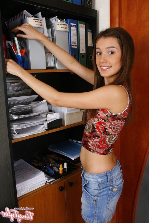 Cute youthful in a blue jean skirt and panties