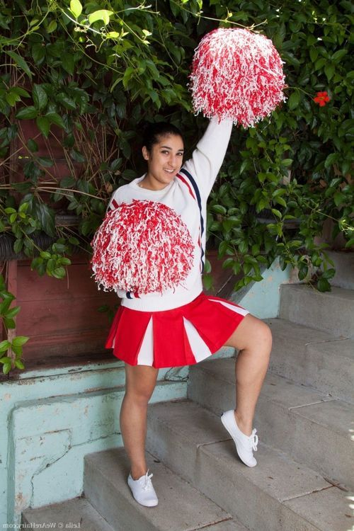 Furry cheerleader leila cheers for us outside
