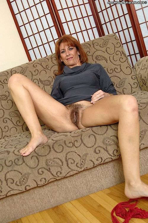 Lusty redhead full-grown model undressing and toying her bushy gash