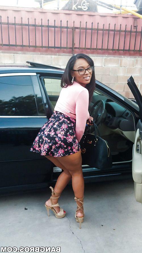 Busty black girl Porsha Carrera bends over in high heels for upskirt