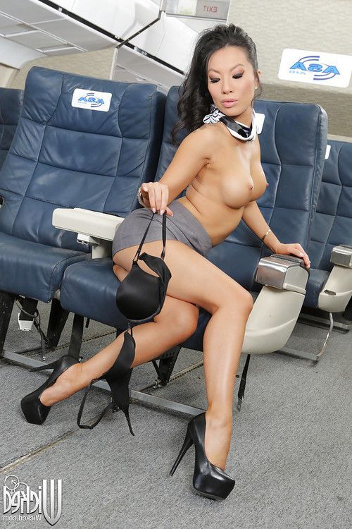 Ravishing asian stewardess performs a steamy stripping scene