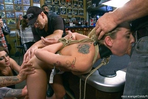 Babe gets tied up, fisted and fucked in real public biker bar