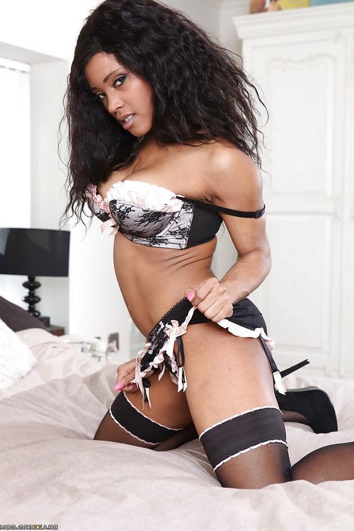 Busty ebony lassie with pierced nipples Kiki Minaj gets rid of her lingerie