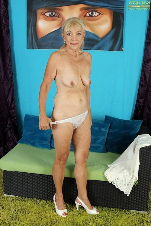 Clothed granny Janet Lesley revealing saggy tits while undressing