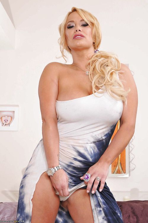 Voluptuous pornstar Shyla Stylez slipping off her dress and panties