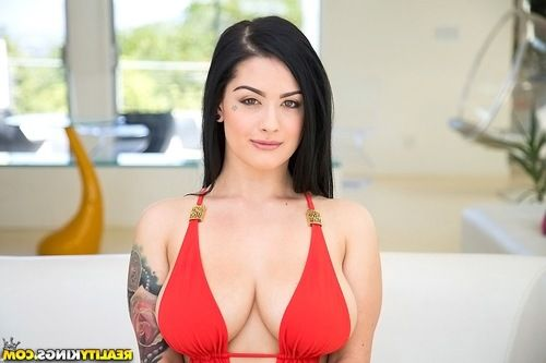 Bikini model with big tits Katrina Jade is showing her sexy tattoos