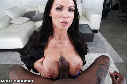 Buxom brunette MILF Nikki Benz giving a huge black cock a tit fucking