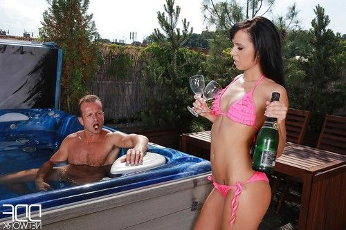 European party girl Gina Devine giving big dick oral sex in outdoor hot tub