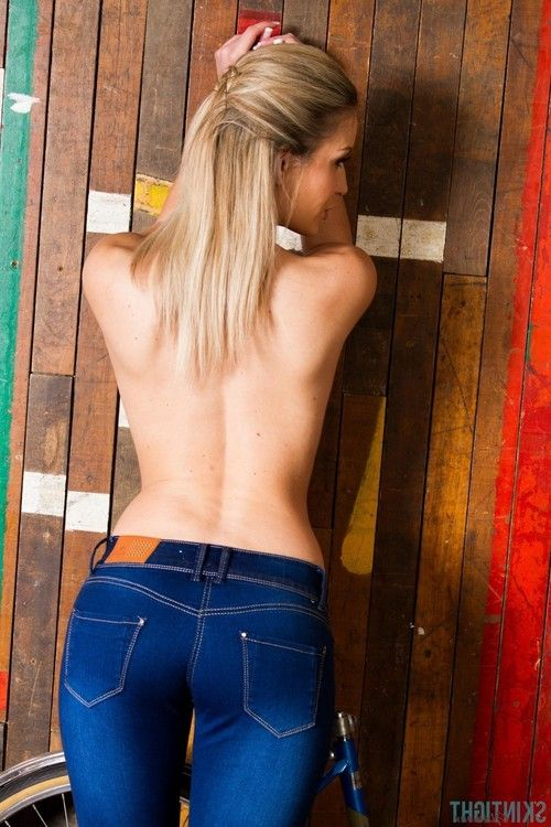 Hot blonde candice posing in her tight blue jeans