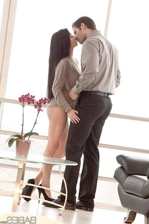 Latina brunette Megan Salinas kissing man before doggystyle sex