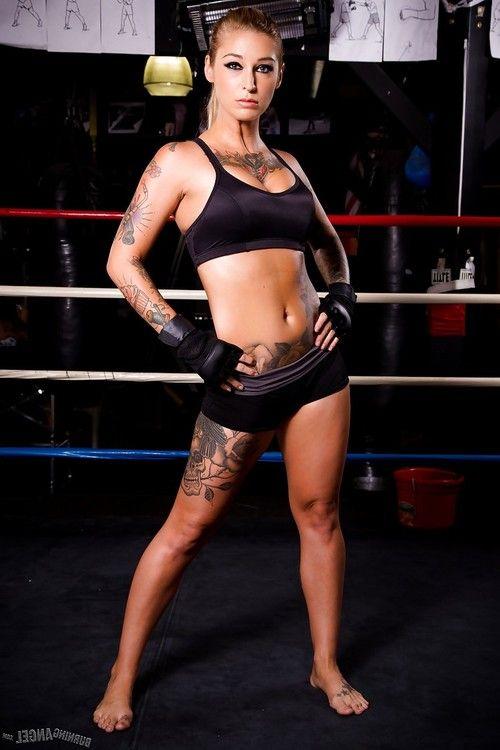 Tattooed MILF pornstar Kleio Valentien in shorts showing big tits in gym