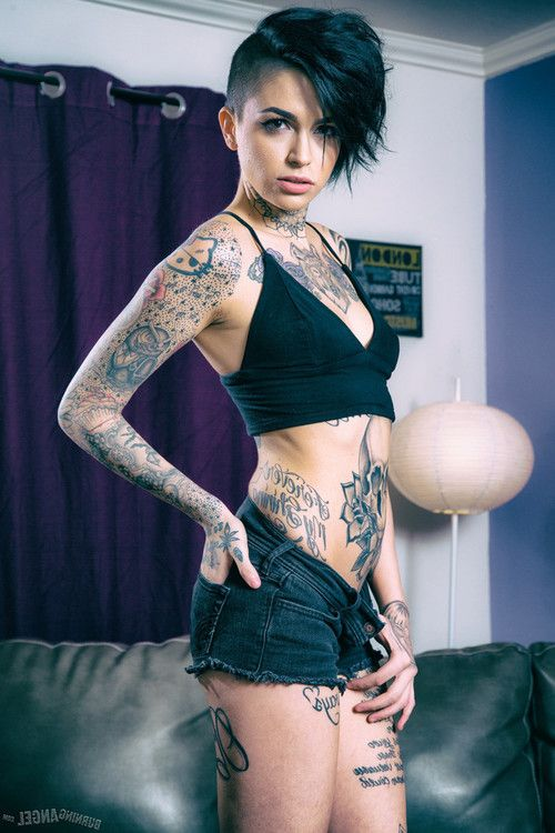 Leigh raven exposes her inked body in the living room