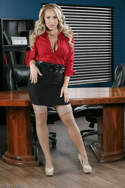 Blonde secretary in stockings Olivia Austin unveils big tits in office