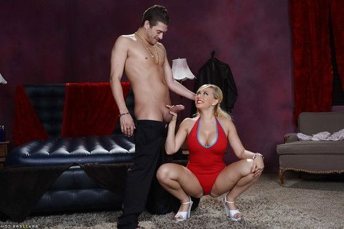 Oiled babe Kagney Linn Karter does a massage to some guys cock
