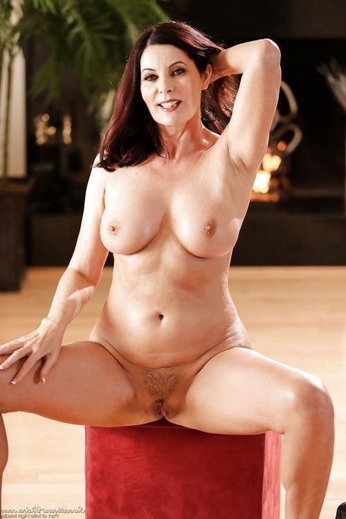 Stunning mature redhead with big tits Magdalene fingers her pussy