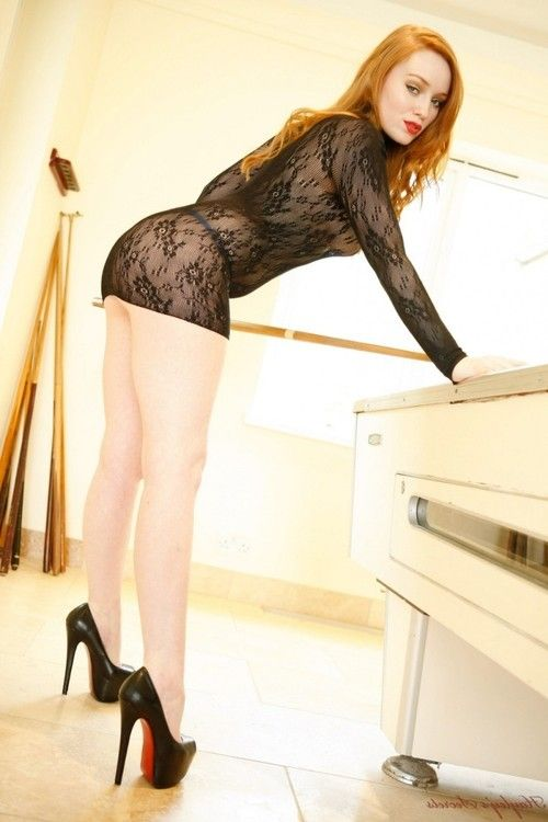 Hot fit redhead on the pool table
