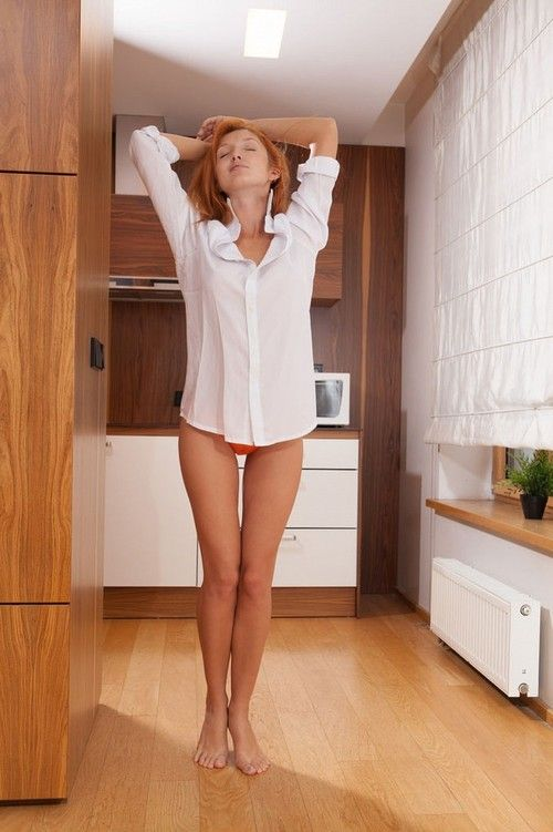Red fox in white shirt and orange panties fingering her pussy