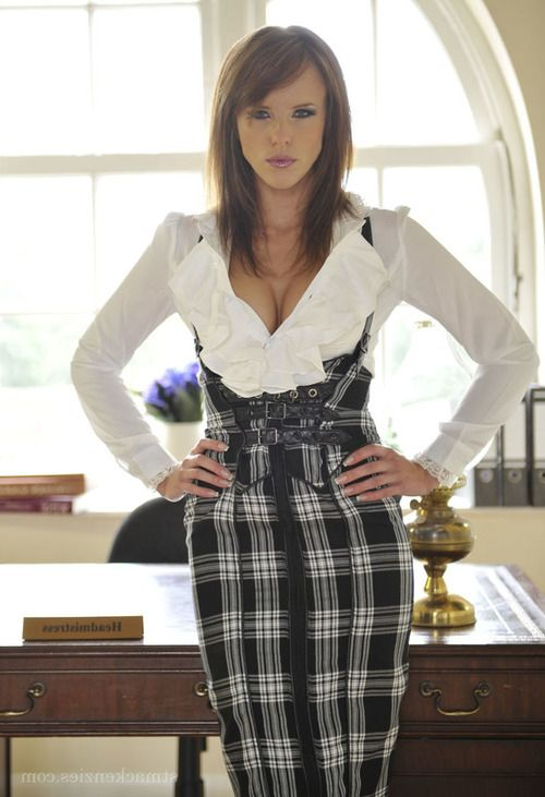 Long legged babe Headmistress Mackenzie drops her sexy miniskirt