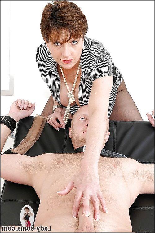 Mature femdom tortures bound guy