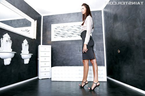 Gorgeous babe in office uniform gets into a messy gloryhole scene